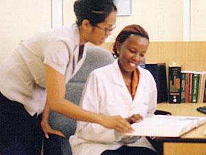 Jennifer Cocohoba with Ugandan clinician