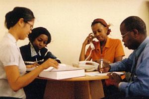 Jennifer Cocohoba with Ugandan clinicians