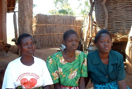 Malawi woman with community workers