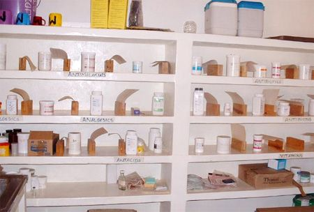 sparse shelves in a Malawi pharmacy