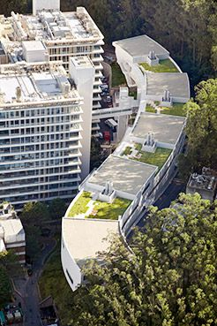 aerial view of the Dolby building curving behind the Health Sciences buildings