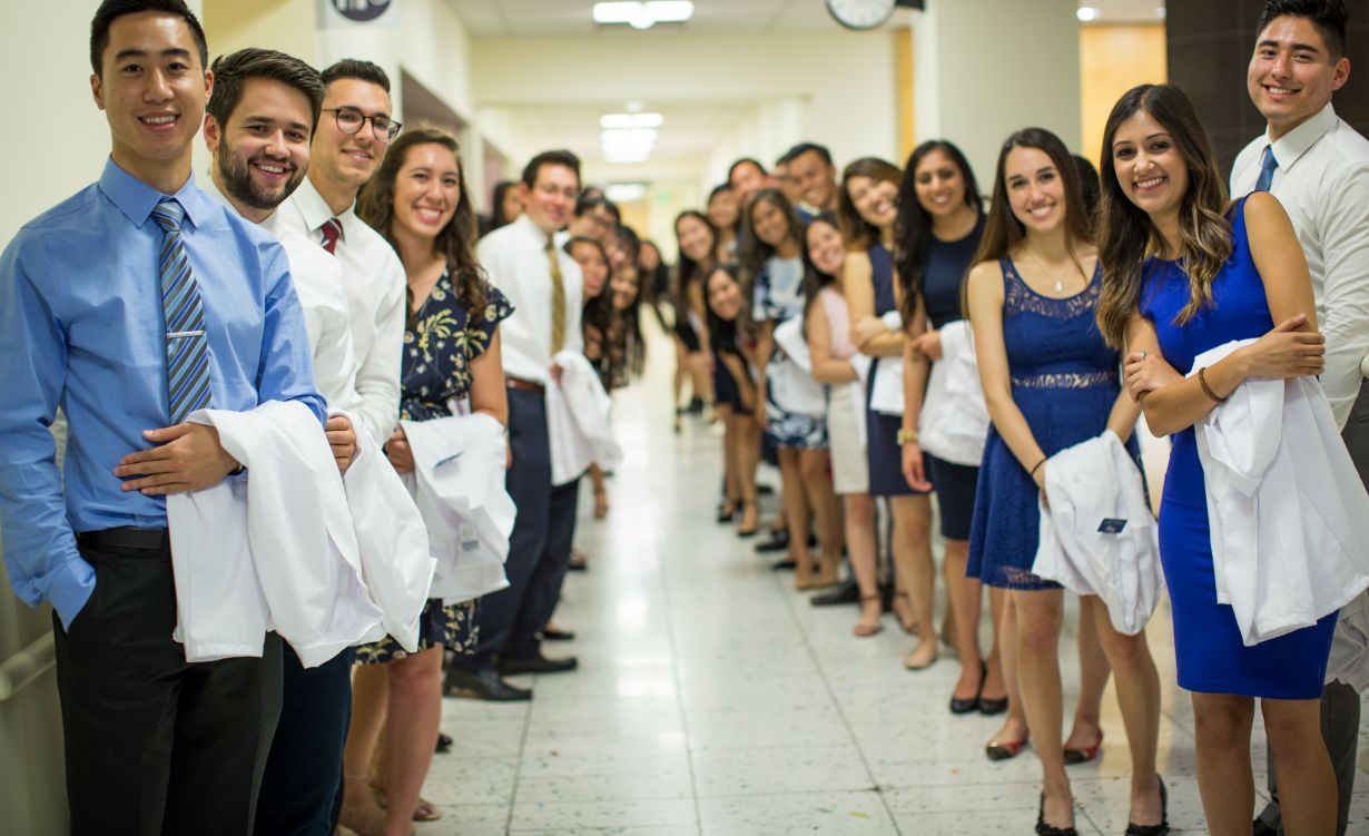 students with white coats