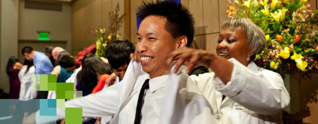 UCSF PharmD student receiving white coat in ceremony