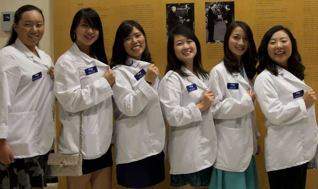 group of six students wearing white coats