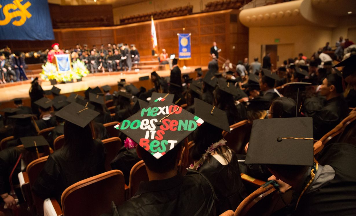 "graduate with slogan on hat: ""Mexico does send its best"""