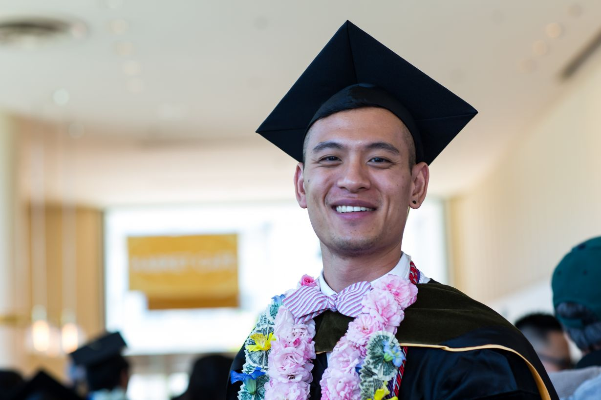 graduate with flower lei
