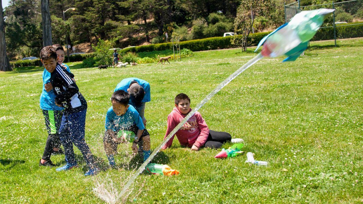 kids launching bottle rocket