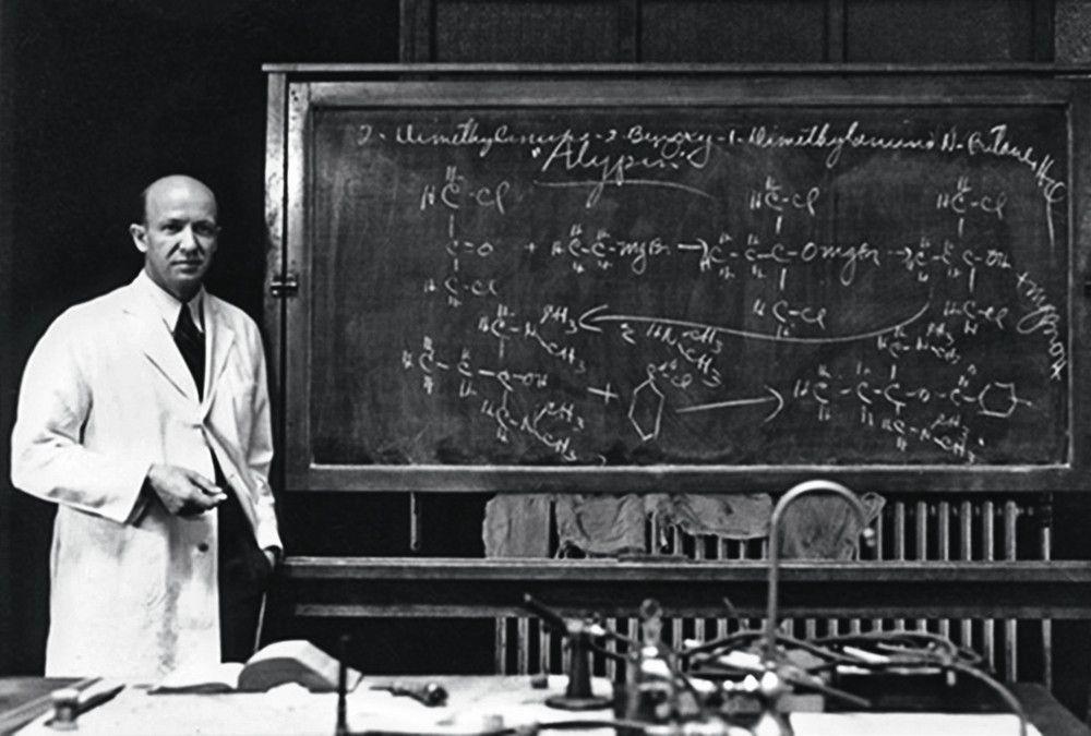 Daniels in front of a chalkboard