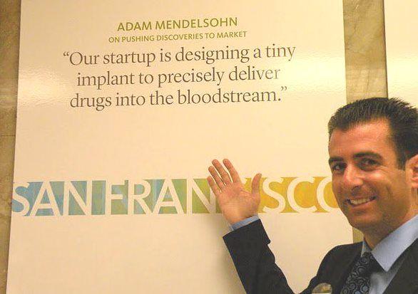 Mendelsohn with poster
