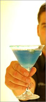 man offering a cocktail