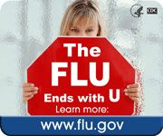 woman holding a sign saying The FLU ends with U, learn more: www.flu.gov