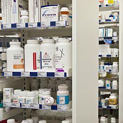 prescription medications on shelves in pharmacy