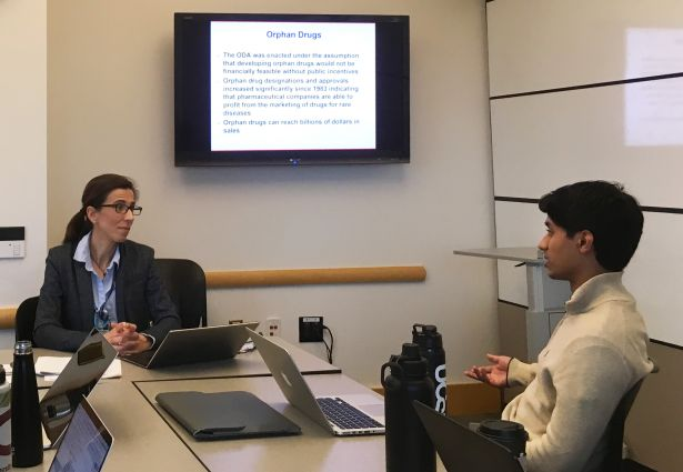 Student in discussion with Rodriguez-Monguio