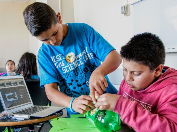 kids building bottle rocket
