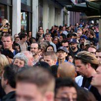crowd of people on sidewalk