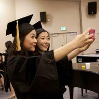 graduates take selfie
