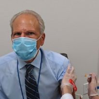 Guglielmo receives flu shot