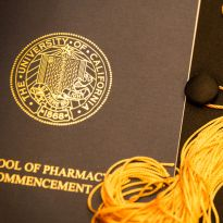 UCSF School of Pharmacy commencement program pamphlet with graduation cap and tassel