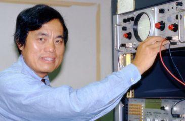 Peng adjusting scientific equipment
