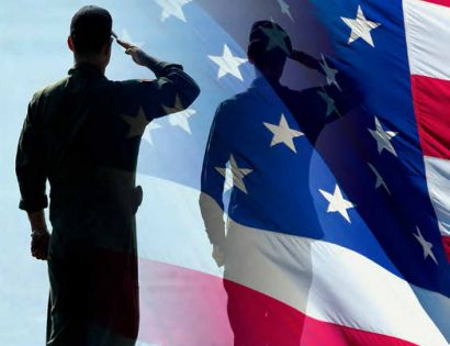 silhouette of soldier against U.S. flag