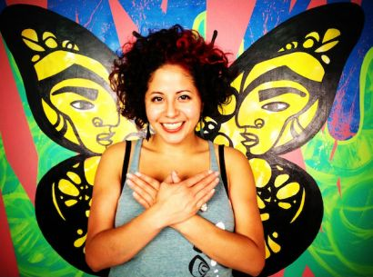 Favianna Rodriguez with butterfly wings