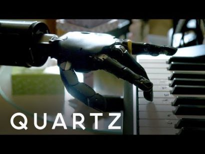 Playing piano with a mind-controlled robotic arm