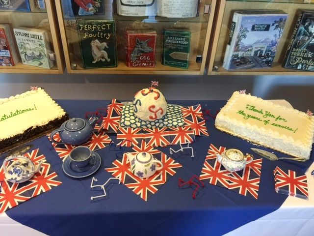 sheet cakes and a tea set laid out on a table decorated with British flags