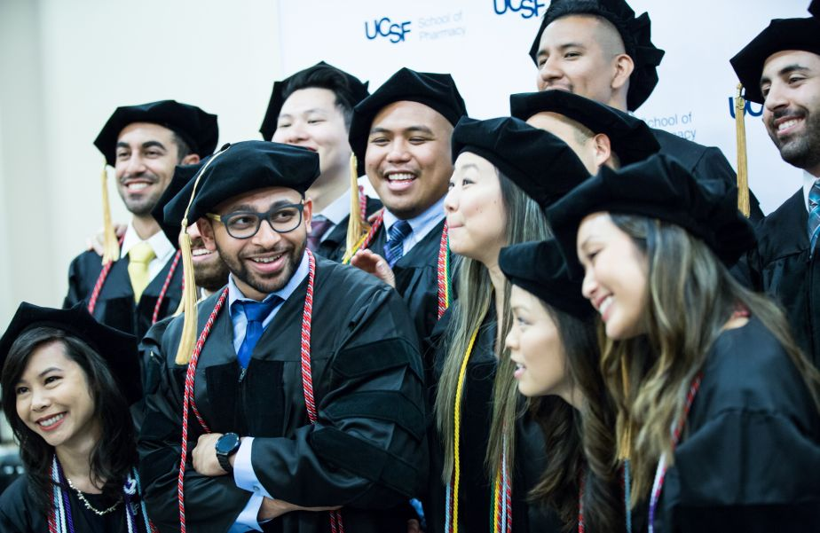 many graduates pose for a group photo.