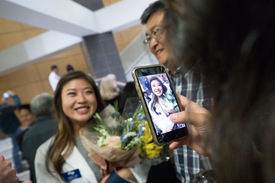 Students celebrate after the White Coat Ceremony