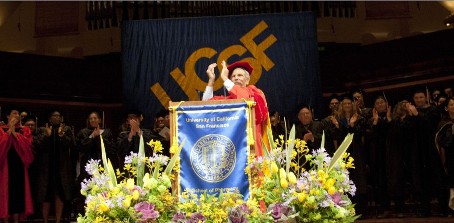 Faculty applauds from stage